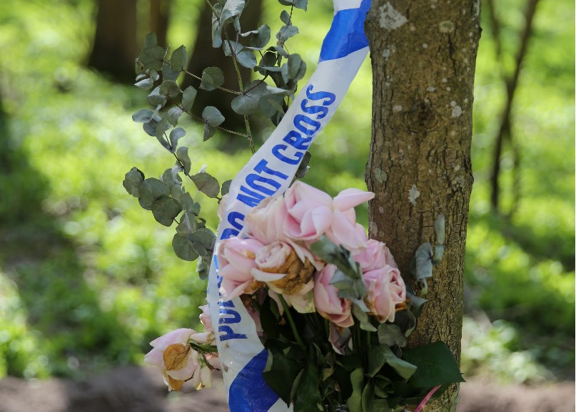 CU flowers and police tape on tree